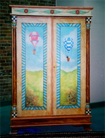 Hand Painted Balloon Armoire by Eugenia Talbott: original hand painted contemporary entertainment armoire with faux finishes, decorative accents and artwork of hot air balloons, from her collection of one of a kind art, decor and furnishings for the home. This exciting piece has been sold - Custom orders are gladly accepted.