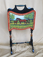 Vintage Magazine Stand with a hand painted scene of a mare and colt. The back side is handpainted to match the style of the front. Custom orders are gladly accepted.