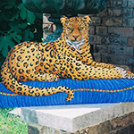 Free standing painting of a leopard, painted on wood