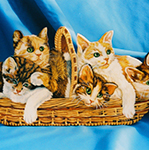 Free standing painting of a basket of kittens, painted on wood.